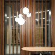 Promenade Aqui by Woods Bagot - Promenade Aqui architecture, ceiling, furniture, interior design, light fixture, lighting, lobby, wall, window, window covering, wood, brown, black