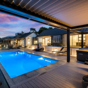 The word 'relax' comes to mind with this apartment, estate, home, house, leisure, lighting, penthouse apartment, property, real estate, resort, roof, swimming pool, villa, black