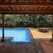 Architect: Studio PKA http://www.purankumar.com/Photographer: Amit Pasricha backyard, deck, floor, flooring, hardwood, house, lighting, outdoor structure, pergola, property, real estate, swimming pool, wood, black