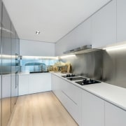 Recessed lighting rings this kitchen, while a window architecture, countertop, interior design, kitchen, product design, real estate, gray