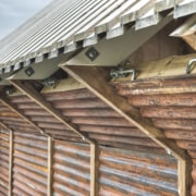Photo: Pasi Aalto / pasiaalto - Detail of beam, facade, roof, siding, structure, wood, brown, gray
