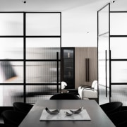 A view from the dining area into the black and white, furniture, interior design, product design, white