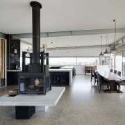 An elevated fireplace is the perfect gathering point floor, house, interior design, living room, gray