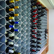 Echelon wine rack modules can be offset from glass, black, gray