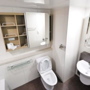 Here's how you make a small bathroom feel bathroom, bathroom accessory, bathroom cabinet, plumbing fixture, product design, property, room, toilet, toilet seat, white
