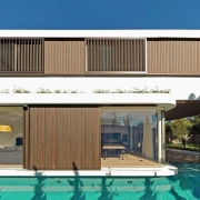 The first floor bedrooms cantilever towards the backyard, architecture, building, elevation, facade, home, house, property, real estate, swimming pool, villa