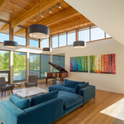 Another view of the living room - Another architecture, ceiling, daylighting, estate, hardwood, home, house, interior design, living room, property, real estate, window, wood, orange