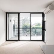 Black door frames and windows draw the eye architecture, daylighting, door, home, house, interior design, property, real estate, window, white