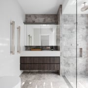A true five-star bathroom, it features a floating bathroom, bathroom cabinet, floor, flooring, interior design, sink, white