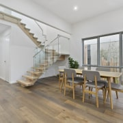 The dining table doesn't intrude – important in architecture, ceiling, daylighting, estate, floor, flooring, hardwood, house, interior design, laminate flooring, property, real estate, stairs, wood, wood flooring, gray