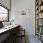 This cozy study area features a large window furniture, interior design, office, shelving, gray