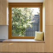 Shelves and drawers run around this window seat door, floor, hardwood, home, interior design, living room, wall, window, window covering, wood, wood flooring, brown, gray