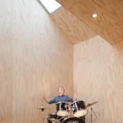 Architect: Steffen Welsch ArchitectsPhotography by Wolf-Peter ceiling, drum, drums, floor, flooring, musical instrument, percussion, table, tom tom drum, wall, wood, gray, orange