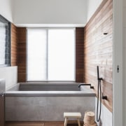 Wood lines the area adjacent to the bathtub, architecture, bathroom, daylighting, floor, flooring, home, house, interior design, room, sink, wall, wood, wood flooring, white, gray