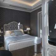 Elegant and contemporary touches line the hotel rooms bedroom, ceiling, interior design, room, suite, wall, gray, black