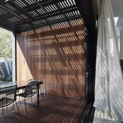 This sheltered outdoor area on the upper level architecture, ceiling, home, house, interior design, property, real estate, roof, shade, window, window treatment, black, gray