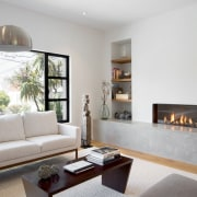 A fireplace keeps the home warm during winters hearth, home, interior design, interior designer, living room, property, real estate, room, gray, white