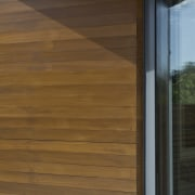 A closer view of the wood outside door, floor, flooring, hardwood, laminate flooring, siding, wall, wood, wood flooring, wood stain, brown