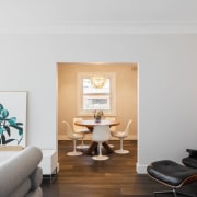 This small formal dining rooms sits off behind architecture, ceiling, floor, home, interior design, living room, property, real estate, room, gray