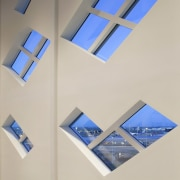 Tetris-like windows line the interior angle, ceiling, daylighting, lighting, product design, gray