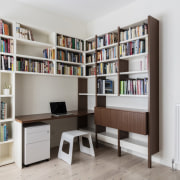 This study features a bookshelf which wraps around bookcase, desk, furniture, library, product design, shelf, shelving, white