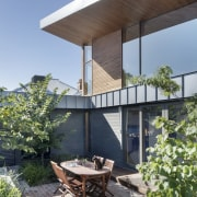 The home is ringed by a private garden architecture, backyard, house, outdoor structure, patio, real estate, gray