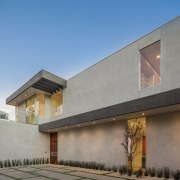 Concrete and glass give the street-facing facade stature architecture, building, elevation, estate, facade, home, house, property, real estate, residential area, gray, teal