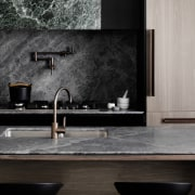 The splashback and countertop share materials - The bathroom, countertop, floor, flooring, interior design, tap, tile, wall, black, gray