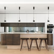 A toughened glass window as a splashback sits cabinetry, countertop, cuisine classique, floor, flooring, furniture, interior design, kitchen, white