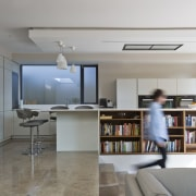 The kitchen features an integrated bookshelf architecture, ceiling, floor, furniture, house, interior design, living room, shelf, shelving, table, gray