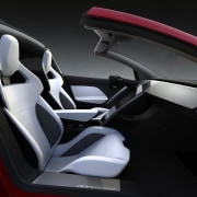 Tesla's new Roadster automotive design, car, car seat, car seat cover, center console, concept car, land vehicle, motor vehicle, personal luxury car, product design, sports car, steering wheel, vehicle, vehicle door, black
