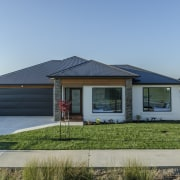 This Sentinel Homes showhome in Twin Parks, Papakura cottage, elevation, estate, facade, home, house, property, real estate, residential area, gray, teal