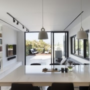 The kitchen faces out to the rooftop garden architecture, ceiling, dining room, house, interior design, living room, table, gray