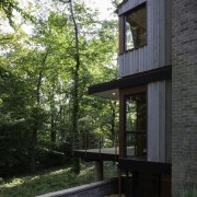 The home is completely private - The home architecture, cottage, home, house, real estate, siding, tree, black