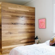 This timber section of the bedroom includes a bed, bed frame, bedroom, door, floor, furniture, hardwood, home, interior design, room, wall, wardrobe, wood, wood stain, white, brown