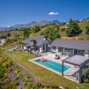 The word 'relax' comes to mind with this aerial photography, bird's eye view, cottage, estate, home, house, land lot, mansion, property, real estate, residential area, suburb, villa, brown