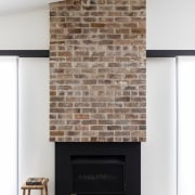 The old 1920s brick fireplace lives on in fireplace, floor, hearth, interior design, living room, wall, white