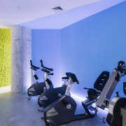 Elements such as the blue warming up zone gym, interior design, room, structure, blue
