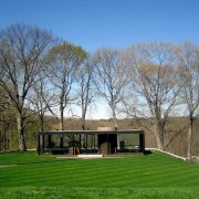 The Glass House by Philip Johnson - The architecture, cottage, estate, farmhouse, grass, grassland, home, house, land lot, landscape, lawn, meadow, pasture, property, real estate, sky, tree, gray
