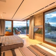 The master bedroom has views out to the architecture, ceiling, estate, house, interior design, penthouse apartment, property, real estate, room, window, orange