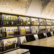 This new whiskey bar takes advantage of a alcoholic beverage, bar, distilled beverage, drink, liquor store, black