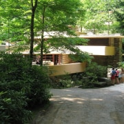 The exterior of Fallingwater enforces a strong horizontal cottage, garden, house, outdoor structure, plant, tree, green