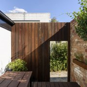 The architect opted to reuse the existing brick architecture, facade, house, outdoor structure, property, real estate, roof, wood, brown