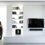 This living room wall features a bookshelf and bookcase, furniture, interior design, product design, shelf, shelving, white