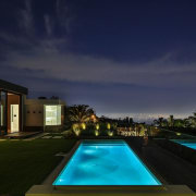The indoor/outdoor living – and the panoramic views architecture, estate, evening, home, house, landscape lighting, leisure, lighting, night, property, real estate, reflection, residential area, resort, sky, swimming pool, villa, blue, black