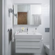 The small bathroom features a floating vanity to bathroom, bathroom accessory, bathroom cabinet, floor, home, interior design, plumbing fixture, product design, room, sink, tap, gray, white
