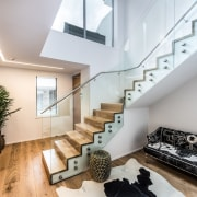 Find out more apartment, architecture, ceiling, daylighting, handrail, house, interior design, living room, loft, property, real estate, stairs, gray
