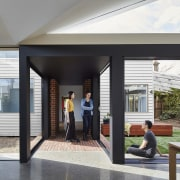 The tunnel opens up to the yard - architecture, door, house, interior design, lobby, window, black, white, gray