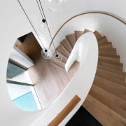 The elliptical stair has 'balanced treads', each tread furniture, product design, stairs, table, wood, white