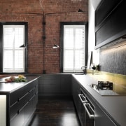 The kitchen is a clear melding of the cabinetry, countertop, cuisine classique, daylighting, floor, flooring, home, interior design, kitchen, room, black, brown